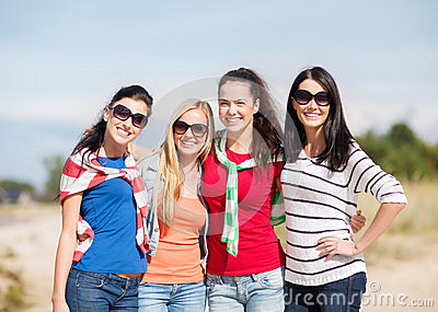 Beautiful teenage girls or young women having fun