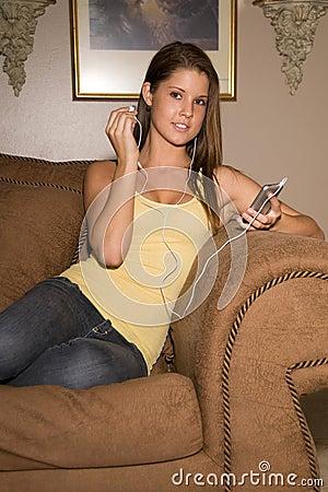 Free Beautiful Teenage Lady Listening To Music. Royalty Free Stock Photos - 5458298