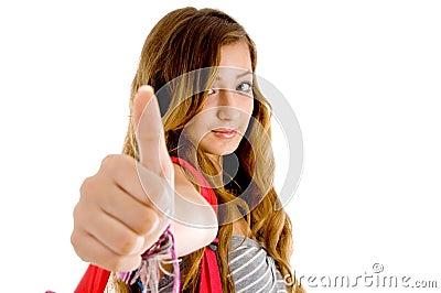 Beautiful teenager school girl showing thumbs up