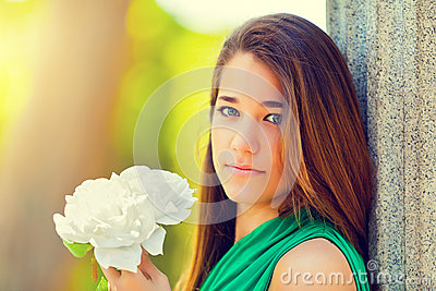 Beautiful Teenager with a White Rose