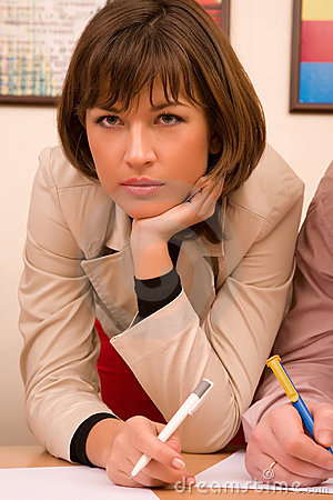 Beautiful thoughtful businesswoman