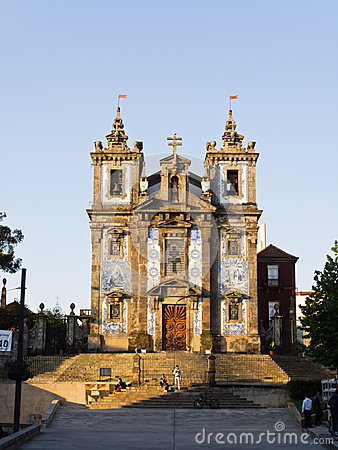 Beautiful tiled bell towers and facade of the Porto Se Editorial Image