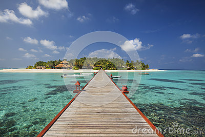 Beautiful tiny island in Maldives in sunny day. Stock Photo