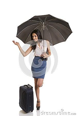 Beautiful traveling businesswoman with umbrella