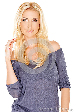Beautiful trendy woman with long blond hair