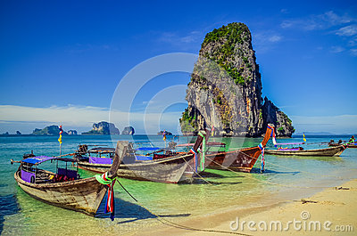 Beautiful tropical ocean beach with long tail boats in Andaman s