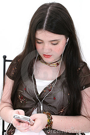 Beautiful Tween Girl Listening To Music