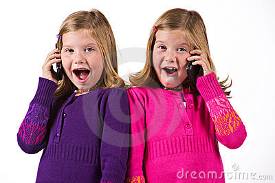 Beautiful twin girls on cell phones