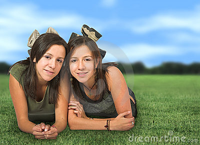 Beautiful twins in a park