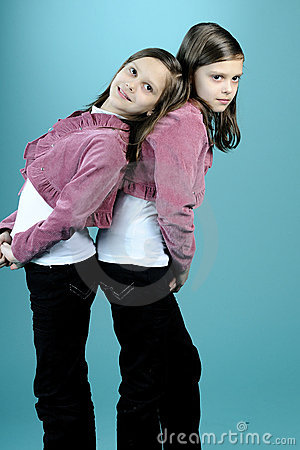 Beautiful twins posing in studio