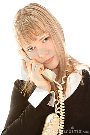 Beautiful upset businesswoman calling by phone
