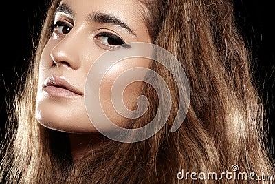 Beautiful volume shiny hair, make-up. Fashion model face
