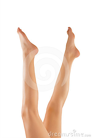 Beautiful wet feet, women legs isolated on white