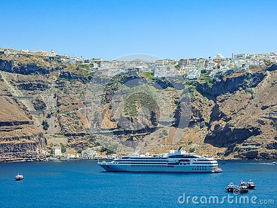 Cruise Ship docked in green harbor Stock Photo