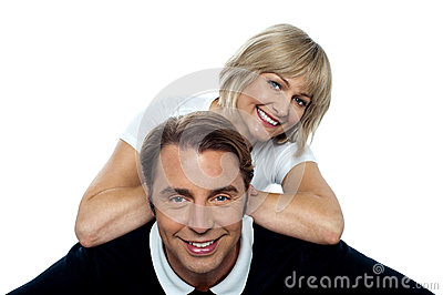 Beautiful wife leaning over her cheerful husband
