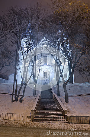 Beautiful winter cityscape at the night - Catholic Church Discal