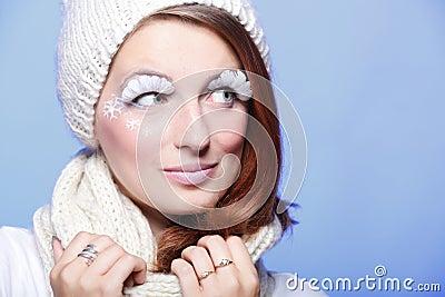 Beautiful winter young woman white eye-lashes
