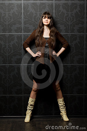 Beautiful woman against wall with pattern