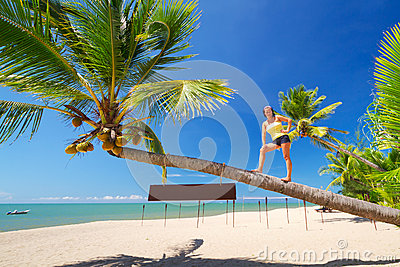 Beautiful woman on the amazing palm tree