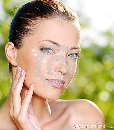 Free Beautiful Woman Applying Cream Near Eyes Stock Photos - 15473783