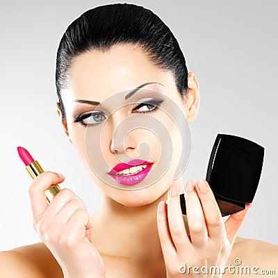 Free Beautiful Woman Applying Pink Lipstick On Lips Royalty Free Stock Photos - 30108198