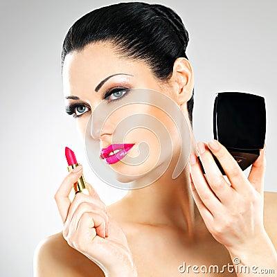 Free Beautiful Woman Applying Pink Lipstick On Lips Stock Images - 34849924
