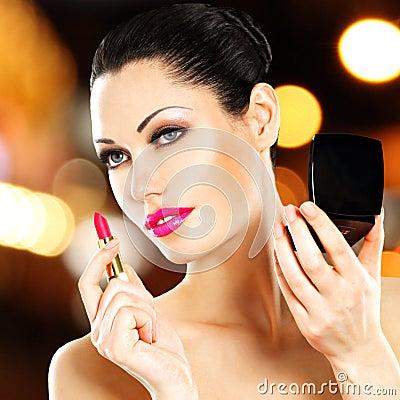 Free Beautiful Woman Applying Pink Lipstick On Lips Stock Photography - 38955392