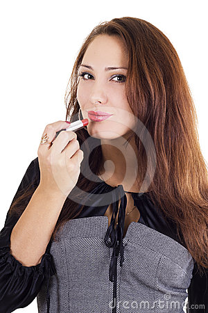 Beautiful woman applying red lipstick