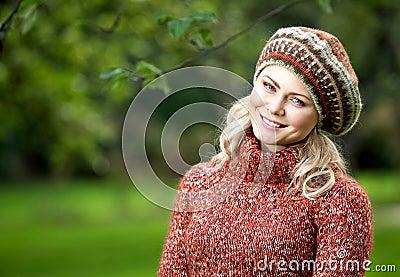 Beautiful woman in autumn wood