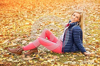 Beautiful woman at the autumnal park