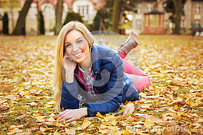 Beautiful woman at the autumnal park