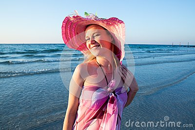 Beautiful woman on background of beach. Persian Gulf ,Dubai.Tanning girl near ocean, tropical resort