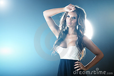 Beautiful woman on background with blue lights