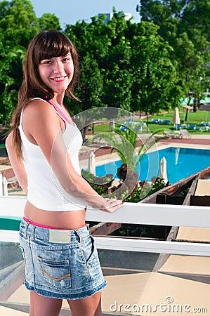 Beautiful woman at balcony of hotel