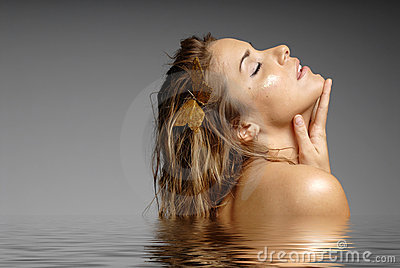 Beautiful woman bathing in water - spa