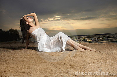A beautiful woman on the beach sunset