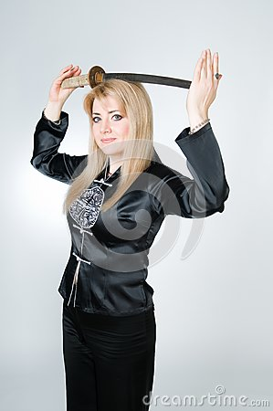 Beautiful woman in black kimono with sword