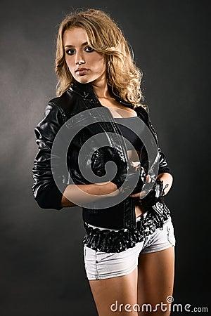 Beautiful woman in black leather jacket