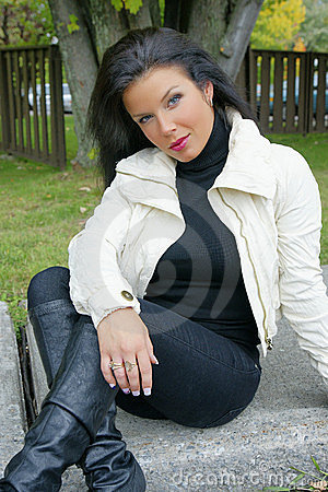 Beautiful woman with black shiny hair in model pos