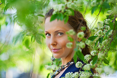 Beautiful fashion woman in a spring garden