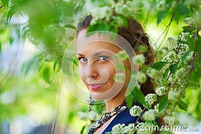 Beautiful fashion woman in a spring garden