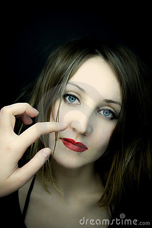 Beautiful woman with blue eyes and red lips