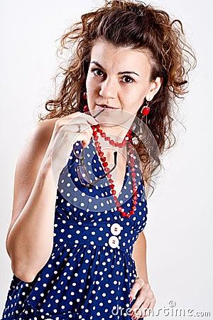 Beautiful woman in a blue polka dot dress