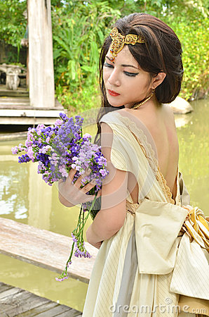 Beautiful woman with bouquet of flower
