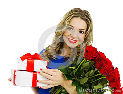 Beautiful woman with bouquet of red roses and gift boxes