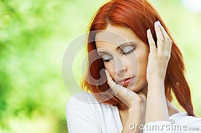 Beautiful woman bowed her head