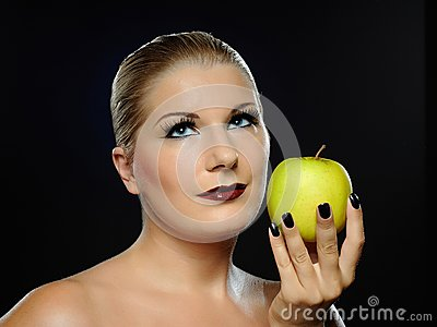 Beautiful woman with bright make-up,apple