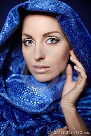 Beautiful woman bright makeup in blue color cloth