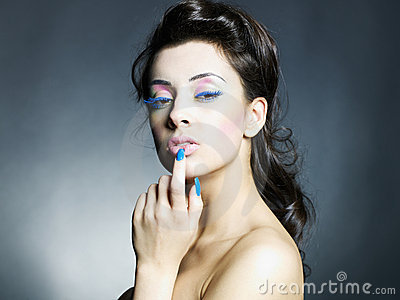 Beautiful woman with bright makeup and manicure
