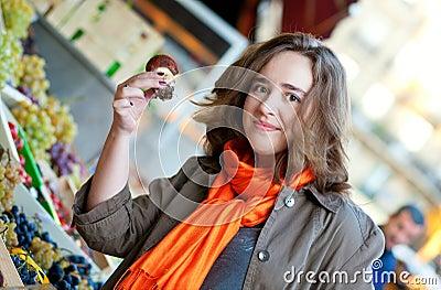 Beautiful woman buying mushrooms